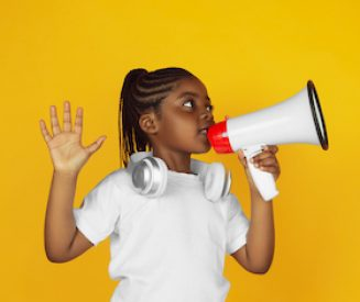 Little african-american girl's portrait isolated on yellow studio background. Beautiful, cheerful kid. Concept of human emotions, facial expression, sales, ad. Copyspace. Looks cute.